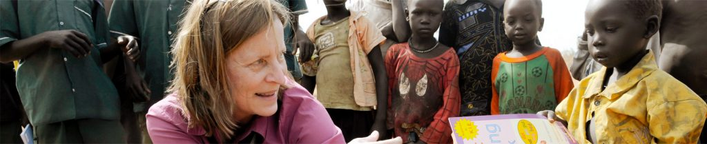 woman serving young african child through International Ministries