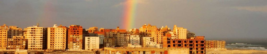 city in foreign country with rainbow in background, God's promise to his people