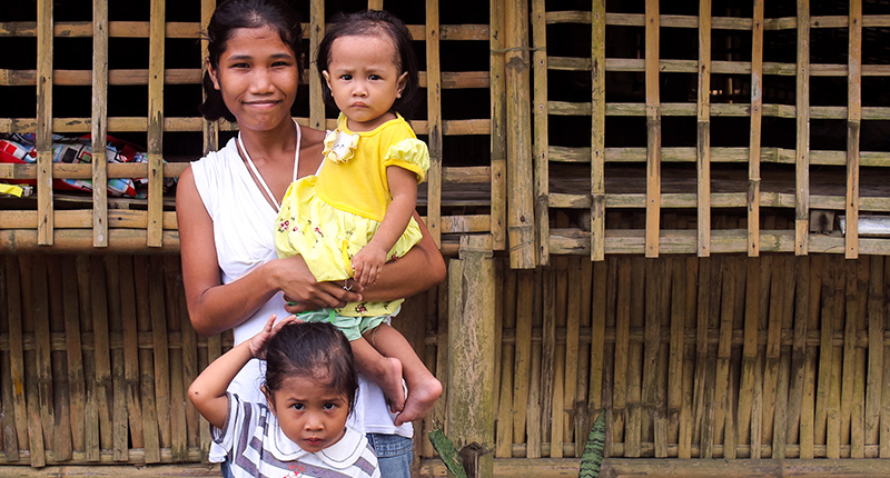 Mother and children in southeast asia, family supported by White Cross